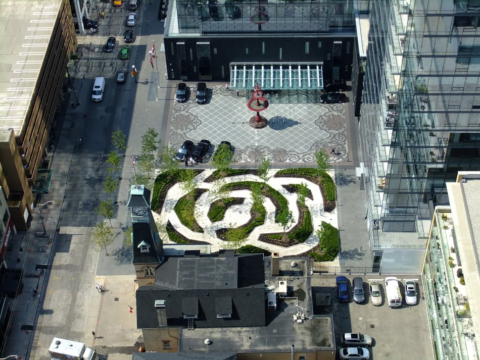 Four Seasons Hotel & Private Residences Claude Cormier Fountain & Garden in shape of a rose from above Yorkville Toronto Victoria Bosariol Chestnut Park Real Estate