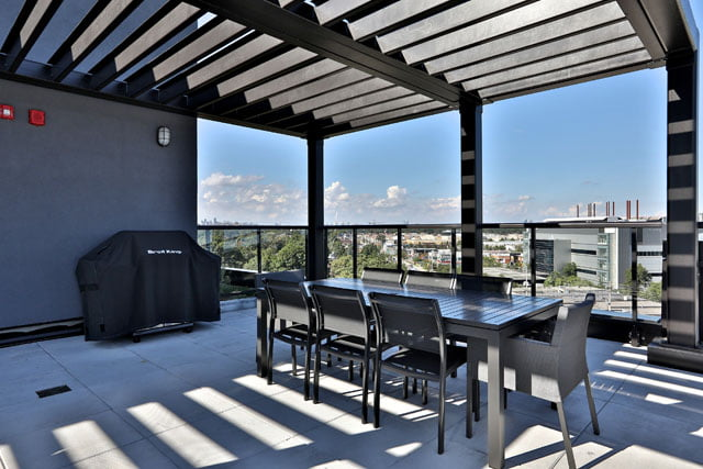 The Upper House Condos Leaside Roof Top Terrace Dining Area BBQ 25 Malcolm Rd Toronto Victoria Boscariol Chestnut Park Real Estate
